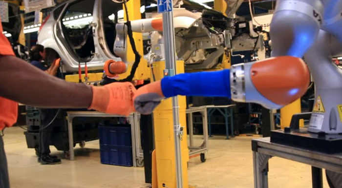 Robots Help Ford Employees Produce Fiesta Cars in Germany