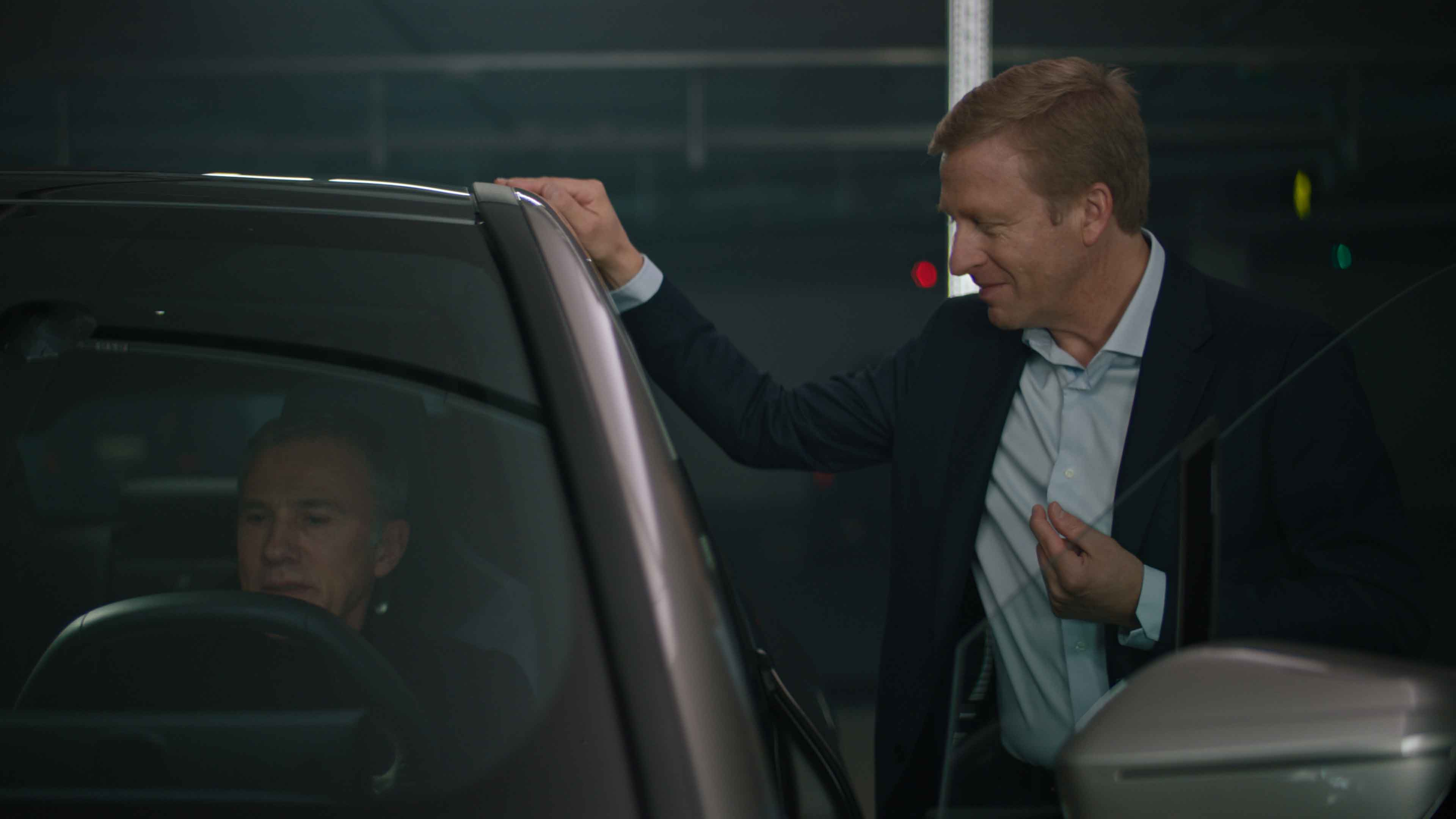 Christoph Waltz and Oliver Zipse, Chairman of the Board of Management of BMW AG, test drive the BMW iX.