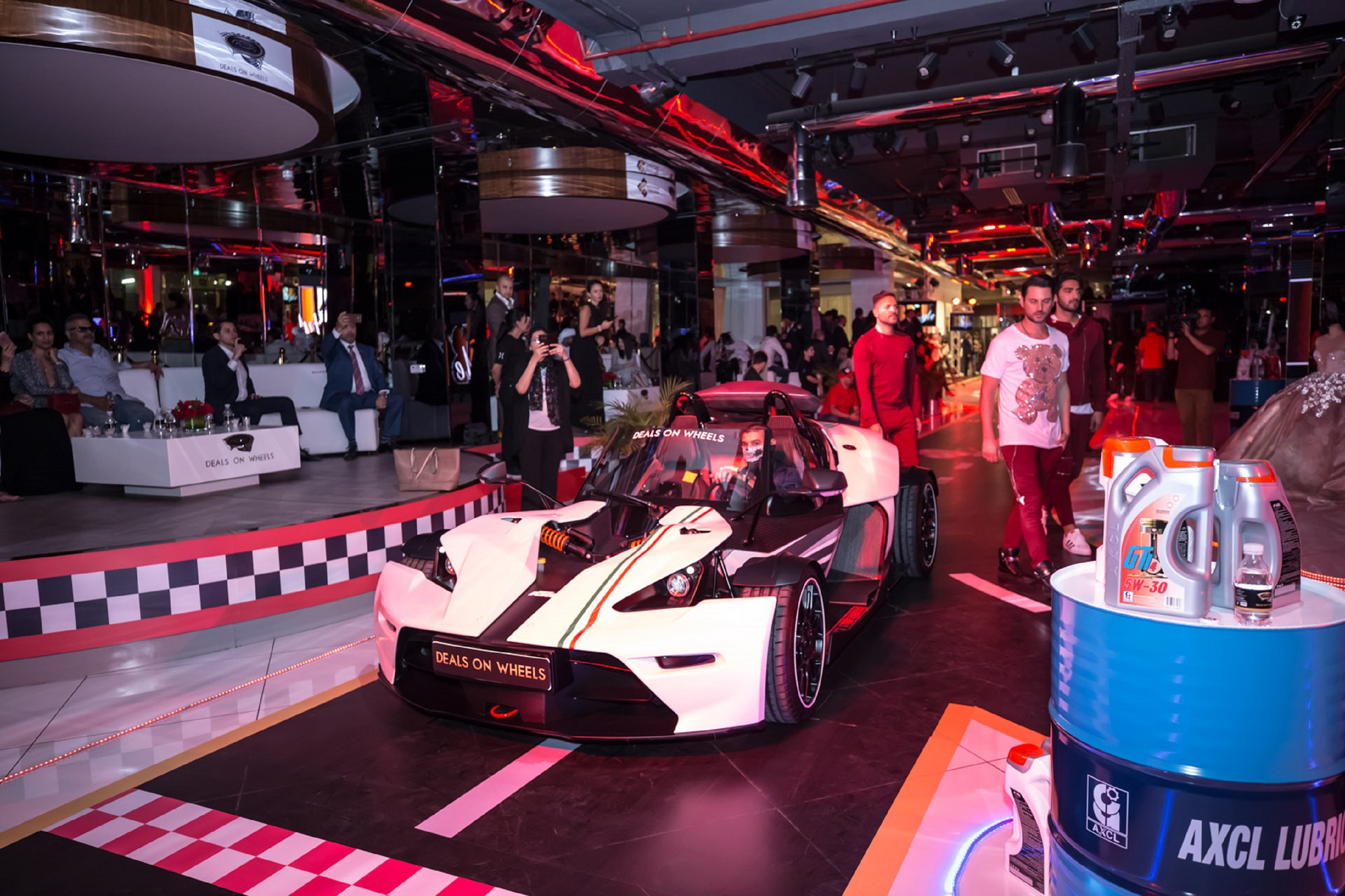 Deals on Wheels Pairs Supercars with Luxury Fashion for Formula One Fashion Show