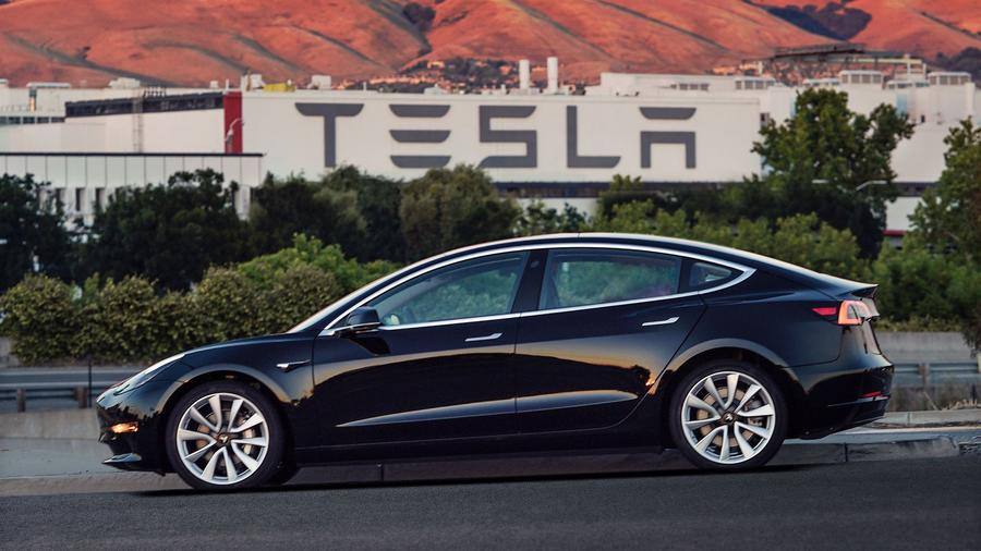 Tesla Hands Over First Model 3 to Customers