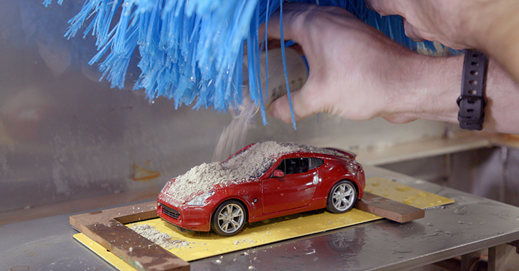 Nissan Conducts Paint Tests with Miniature Car Wash
